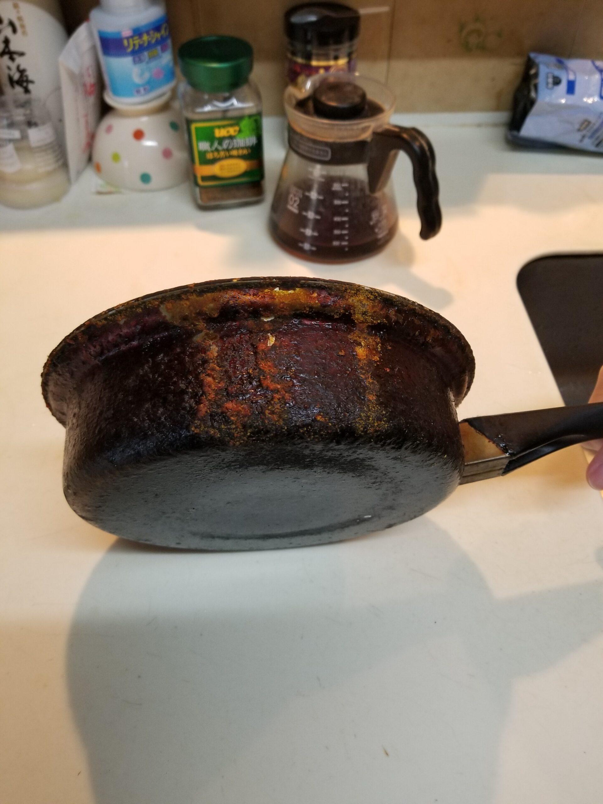 油まみれのステンレス鍋